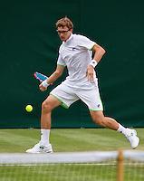 25-06-13, England, London,  AELTC, Wimbledon, Tennis, Wimbledon 2013, Day two, Denis Istomin (UZB)<br /> <br /> <br /> <br /> Photo: Henk Koster