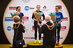 © Joel Goodman - 07973 332324. 15/10/2017 . Manchester , UK . Women's winners L-R SARAH MACKNESS (3rd) , REBECCA HILLAND (1st) and JULIE BRISCOE (2nd) on the podiums at the end of the Greater Manchester Half Marathon in Old Trafford . Photo credit : Joel Goodman