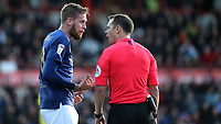 Pontus Jansson of Brentford and match referee, Stuart Attwell during Brentford vs Millwall, Sky Bet EFL Championship Football at Griffin Park on 19th October 2019