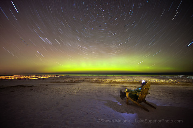 Startrails and aurora borealis, northern lights over Upper Michigan, Lake Superior on a beach in Marquette. Featured on National Geographic News and MSNBC in between Feb 27 and March 2, 2012