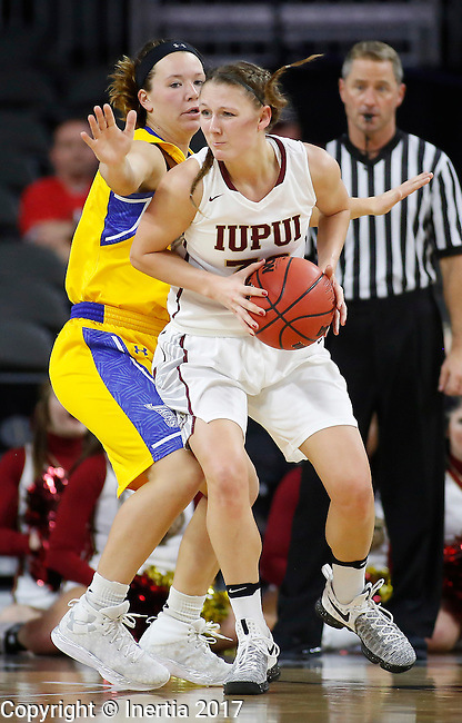 SIOUX FALLS, SD: MARCH 6: Jenna Gunn #32 of IUPUI spins around South Dakota State defender Sydney Palmer #32 during the Summit League Basketball Championship on March 6, 2017 at the Denny Sanford Premier Center in Sioux Falls, SD. (Photo by Dick Carlson/Inertia)