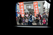 People line the motorcade route as United States President Barack Obama makes his way to Kotoku-In Temple in Kamakura, Japan, November 14, 2010. .Mandatory Credit: Pete Souza - White House via CNP