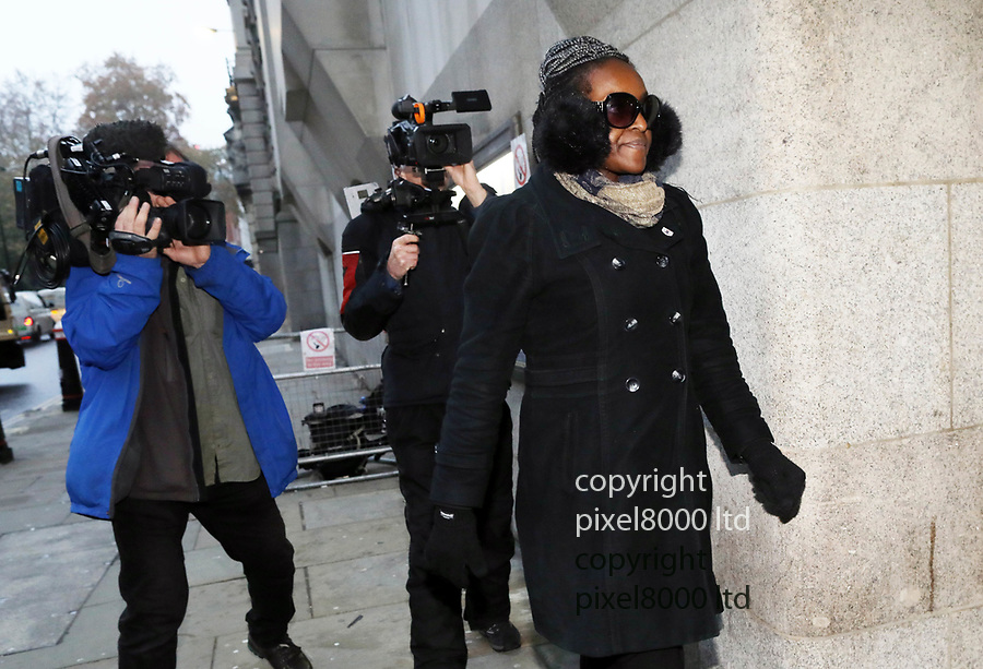 Pic shows: Labour MP Fiona Onasanya arrives at the Old Bailey to hear the verdict in her trial for Perverting the Course of Justice.<br /> <br /> She stepped out of a cab wearing huge ear muffs and dark glasses past a gaggle of waiting TV cameramen.<br /> <br /> <br /> <br /> pic by Gavin Rodgers/Pixel8000