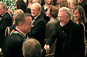 Kris Kristofferson shakes hands with Tom Hanks following the reception in the East Room of the White House in Washington, D.C. for the  37th Kennedy Center Honorees on Sunday, December 7, 2014.<br /> Credit: Dennis Brack / Pool via CNP