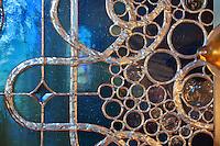 Section of a stained glass window with many circles in the leadwork, in the Bell tower room themed 'Le Merveilleux' or The Supernatural, first floor, in Le Tresor de la Cathedral d'Angouleme, in Angouleme Cathedral, or the Cathedrale Saint-Pierre d'Angouleme, Angouleme, Charente, France. The 12th century Romanesque cathedral was largely reworked by Paul Abadie in 1852-75. In 2008, Jean-Michel Othoniel was commissioned by DRAC Aquitaine - Limousin - Poitou-Charentes to display the Treasure of the Cathedral in some of its rooms, which opened to the public on 30th September 2016. Picture by Manuel Cohen. L'autorisation de reproduire cette oeuvre doit etre demandee aupres de l'ADAGP/Permission to reproduce this work of art must be obtained from DACS.