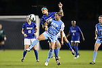 18 October 2012: UNC's Amber Brooks (22) and Duke's Kim DeCesare (behind) challenge for the ball. The University of North Carolina Tar Heels defeated the Duke University Blue Devils 2-0 at Koskinen Stadium in Durham, North Carolina in a 2012 NCAA Division I Women's Soccer game.