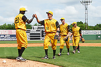 Jacksonville Suns pitcher Juancito Martinez (28) fist bumps Austin Nola (36), Greg Nappo (34) and Terrence Dayleg (16) after the 20th Annual Rickwood Classic Game against the Birmingham Barons on May 27, 2015 at Rickwood Field in Birmingham, Alabama.  Jacksonville defeated Birmingham by the score of 8-2 at the countries oldest ballpark, Rickwood opened in 1910 and has been most notably the home of the Birmingham Barons of the Southern League and Birmingham Black Barons of the Negro League.  (Mike Janes/Four Seam Images)