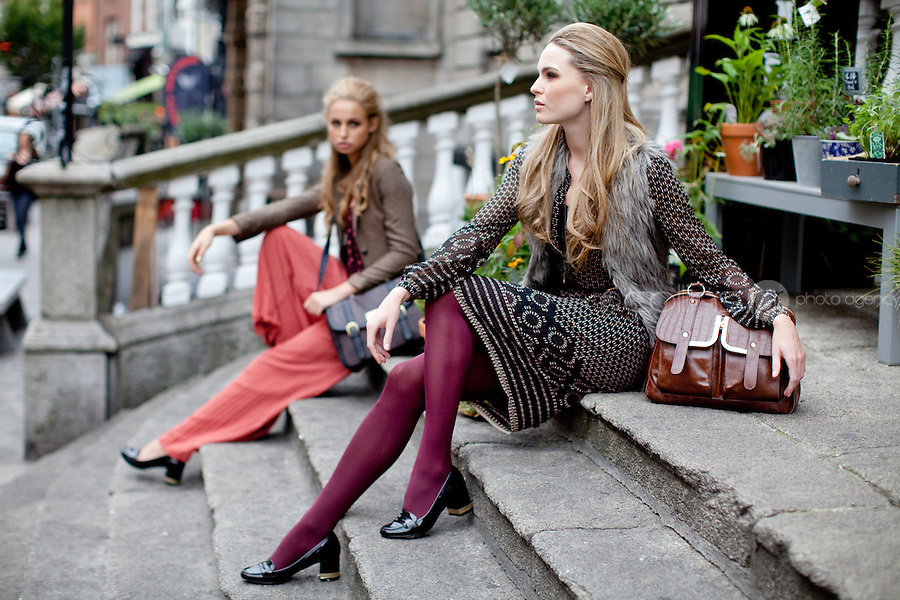 NO REPRO FEE. 31/8/2011. A wear's new autumn '11 collection. Sarah Morrissey & Thalia Heffernan model a selection of dresses at the Powerscourt Town House Dublin. Sarah wears Black print dress - EUR45, Fur gilet - EUR55 and Black belt - EUR8Thalia wears a Paisley frill top - EUR35, Pleated palazzo pant -EUR50, Heritage blazer - EUR60,Brown satchel - EUR30 and Belt - EUR8. The full range is available in all A wear stores and online at www.awear.com now. Picture James Horan/Collins Photos