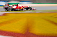 March 14, 2014: Fernando Alonso (ESP) from the Scuderia Ferrari team rounds turn three during practice session one at the 2014 Australian Formula One Grand Prix at Albert Park, Melbourne, Australia. Photo Sydney Low.