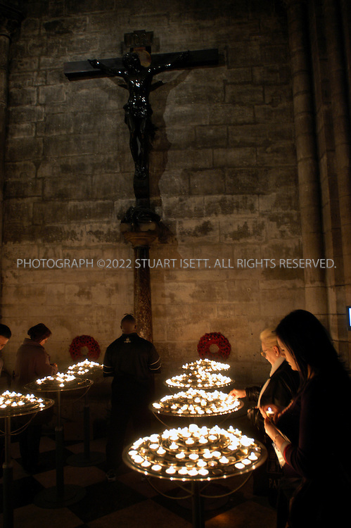 4/1/2005--Paris, France..Worshippers at Paris's Notre Dame Cathedral light candles and offer prayers as the Pope's condition in the Vatican continues to worse...All photographs ©2005 Stuart Isett.All rights reserved.