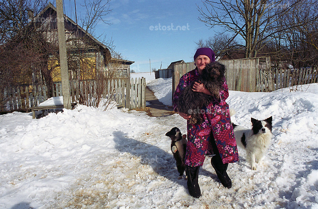 Belarus/Weissrussland, 2005/03/23<br /> KOLSCHITCHI. Maril Petrovna Povlyuskov and his husbend Evgenyi are only inhabitans of abandoned village Kolschitchi in Chernobyl zone (Mogilev region, Belarus). Simirarly like hundred others villages in Belarus, also Kolschitchi has been evacuated and most of houses burried into ground after the Chernobyl disaster because of severe radioaktivity. Maril Petrovna offered shelter to abandoned dogs from neighbourhood.<br /> ? Vaclav Vasku/EST&amp;OST.