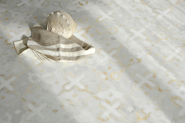 Huelva, a stone waterjet mosaic shown in honed Heavenly Cream, polished Cloud Nine and Thassos, is part of the Miraflores collection by Paul Schatz for New Ravenna.<br />