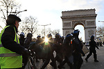 Gilets Jaunes - Yellow Vests in Paris Champs Elysee unrest in Paris, France on March the 02 of 2019.  Pictured : A Yellow Vest and CRS Policemen in front of Arc de Triomphe<br />  © Pierre Teyssot