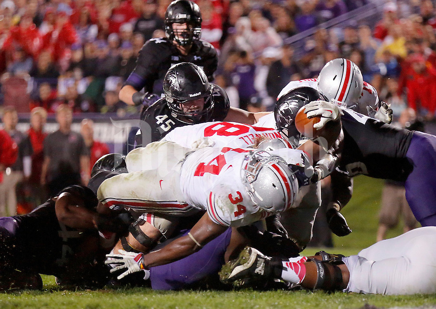 Ohio State Buckeyes running back Carlos Hyde (34) reaches for what was reviewed to be a touchdown during the second half of the NCAA football game between Ohio State and Northwestern at Ryan Field in Evanston, Illinois on Saturday, October 5, 2013. (Columbus Dispatch photo by Jonathan Quilter)