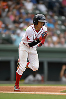 Right fielder Lorenzo Cedrola (5) of Greenville Drive runs out a batted ball in a game against the Hickory Crawdads on Sunday, July 16, 2017, at Fluor Field at the West End in Greenville, South Carolina. Hickory won, 3-1. (Tom Priddy/Four Seam Images)