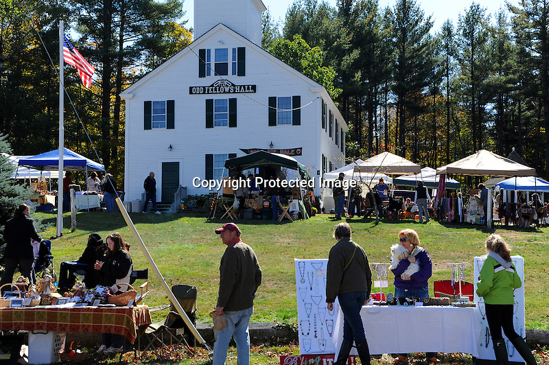 People enjoying the annual Harvest Festival in the village of Marlow, New Hampshire USA