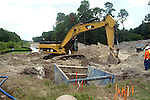 The excavator operator can use the bucket arm to level the excavator and allow him to drive out of a soft area.
