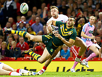 Picture by Alex Whitehead/SWpix.com - 26/10/2013 - Rugby League - Rugby League World Cup - Australia v England - the Millennium Stadium, Cardiff, Wales - Australia's Greg Inglis makes an acrobatic pass to set up Jonathan Thurston's try. Rugby League World Cup 2013 re edited 11/10/2017 Best Of