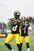 August 8, 2009; Hamilton, ON, CAN; Hamilton Tiger-Cats wide receiver Corey Grant (8). CFL football: Edmonton Eskimos vs. Hamilton Tiger-Cats at Ivor Wynne Stadium. The Tiger-Cats defeated the Eskimos 28-21. Mandatory Credit: Ron Scheffler. Copyright (c) 2009 Ron Scheffler.
