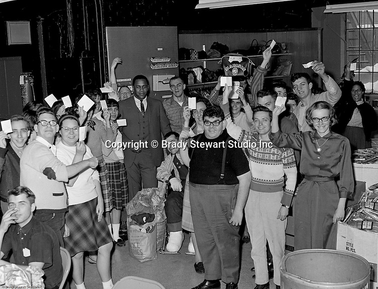Pittsburgh PA:  Goodwill employees and Willie Stargell of the Pittsburgh Pirates, asking for your donation to the Goodwill of Pittsburgh - 1966.<br />