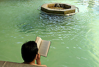 Reading and Soaking at Calistoga Spa.