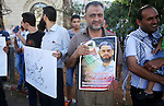Protesters participate in a demonstration supporting the Palestinian prisoner in Israeli jails Mohammad Allan, during a protest in the West Bank city of Ramallah, on August 14, 2015. The Israeli military prosecutor intends to request court permission on Saturday to force-feed hunger striking prisoner Mohammad Allan, the Palestinian minister of prisoner affairs, Issa Qaraqe announced on Friday. Allan, a lawyer from the occupied West Bank city of Nablus, has been on hunger strike for at least 60 days in protest of his detention without charge or trial since his arrest in November. Photo by Shadi Hatem