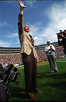Former Green Bay Packers quarterback and coach Bart Starr waves to Packers' fans at Lambeau Field in 1996. Part of the Packers' commitment to the fans involves bringing back past Packers for an alumni appreciation day.