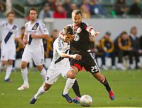 CARSON, CA - March 18,2012: LA Galaxy defender AJ DeLaGarza (2) and DC United forward Maicon Santos (29) during the LA Galaxy vs DC United match at the Home Depot Center in Carson, California. Final score LA Galaxy 3, DC United 1.