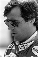WEST ALLIS, WI - JUNE 2: Danny Sullivan waits to drive his March 85C/Cosworth in the Miller American 200 CART IndyCar race at the Milwaukee Mile oval track in West Allis, Wisconsin, on June 2, 1985.