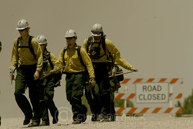 South of New Harmony, UT--27 Jun 2005--.Members of the Logan Hot Shots arrive at the Blue Ridge fire and will work to put out hot spots to help contain the fire..**Pictures from the Blue Ridge fire to the west of I-15 and South of New Harmony.**.Chris Detrick /Salt Lake Tribune.File #Blue Ridge Fire CD13