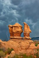 792800273v lightning flashes behind the four trolls red rock formations during a summer thunderstorm in devils garden escalante grand staircase national monument utah united states