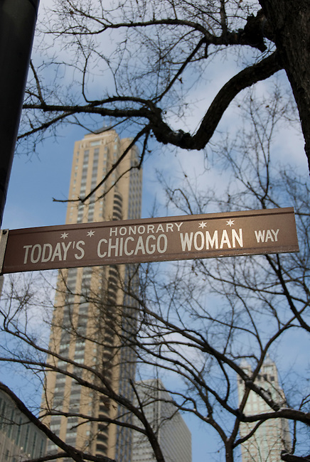 """""""Today's Chicago Woman Way"""" street sign along Michigan Avenue on the """"Magnificent Mile"""" during winter morning in downtown, Chicago, Illinois, USA"""