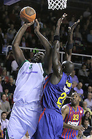 20.03.2012 Barcelona, Spain. Euroleague Playoff game 1. Picture show Nathan Jawai (L) and Boniface Ndong (R) in action during match between FC Barcelona Regal against Unics Kazan at Palau Blaugrana