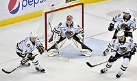 HERSHEY, PA - NOVEMBER 28: HERSHEY, PA - NOVEMBER 28: Hershey Bears goalie Ilya Samsonov (1) faces a shot while Tyler Lewington (2), Jason Megna (36), and Tobias Geisser (33) protect the front of the net during the Wilkes-Barre/Scranton Penguins at Hershey Bears on November 28, 2018 at the Giant Center in Hershey, PA. (Photo by Randy Litzinger/Icon Sportswire)