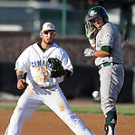 SIOUX FALLS, SD - JULY 18:  Cory Morales #5 from the Sioux Falls Canaries gathers the ball as Drew Martinez #5 from the Gary South Shore Rail Cats stands on second after a double in the second inning of their gameThursday evening at the Sioux Falls Stadium.(Photo by Dave Eggen/Inertia)