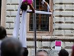 Trento Buskers Festival 2015. Company Nasoallinsu artists perform aerial silk and hoop at Trento, Italy - 12 of September, 2015 - www.nasoallinsu.it - Photo credit Pierre Teyssot