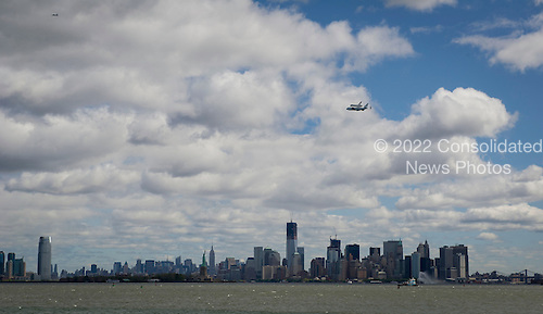 Space shuttle Enterprise, mounted atop a NASA 747 Shuttle Carrier Aircraft (SCA), is seen as it flies over the Hudson River, Friday, April 27, 2012, in New York. Enterprise was the first shuttle orbiter built for NASA performing test flights in the atmosphere and was incapable of spaceflight. Originally housed at the Smithsonian's Steven F. Udvar-Hazy Center, Enterprise will be demated from the SCA and placed on a barge that will eventually be moved by tugboat up the Hudson River to the Intrepid Sea, Air & Space Museum in June. .Mandatory Credit: Bill Ingalls / NASA via CNP