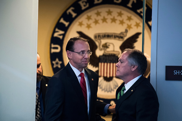"UNITED STATES - MAY 11: James Wolfe, right, security director for the Senate Intelligence Committee, holds the door as Deputy Attorney General Rod Rosenstein, left, leaves a meeting with Chairman Richard Burr, R-N.C., and Ranking Member Mark Warner, D-Va., after a Senate (Select) Intelligence Committee hearing in Hart Building titled ""World Wide Threats"" on May 11, 2017. (Photo By Tom Williams/CQ Roll Call)"