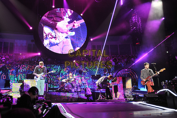 Coldplay performing live in concert, O2 Arena, Greenwich, London, England. .9th December 2011.stage gig performance music full length blue jacket  black singing piano guitar hat .CAP/MAR.© Martin Harris/Capital Pictures.