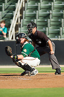 Greensboro Grasshoppers catcher Chad Wallach (47) sets a target as home plate umpire Grant Conrad looks on during the South Atlantic League game against the Kannapolis Intimidators at CMC-NorthEast Stadium on August 31, 2014 in Kannapolis, North Carolina.  The Grasshoppers defeated the Intimidators 3-1.  (Brian Westerholt/Four Seam Images)