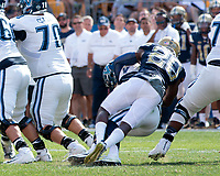 Pitt defensive back Dennis Briggs sacks the quarterback. The Pitt Panthers defeated the Villanova Wildcats 28-7 at Heinz Field, Pittsburgh, Pennsylvania on September 3, 2016.