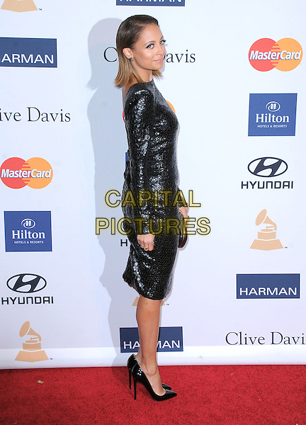 Nicole Richie.at The  Pre-GRAMMY Gala & Salute to Industry Icons with Clive Davis Honoring Antonio L.A. Reid held at The Beverly Hilton Hotel in Beverly Hills, California, USA, February 9th 2x013.                                                               .full length eighties 80s dress long sleeve clutch bag shoes black slicked back hair bob straight beauty black shoulder pads shiny patterned snake croc eyeliner make-up earring make-up pointy shoes red nails manicure ring polish varnish side heels christian louboutin .CAP/DVS.©Debbie VanStory/Capital Pictures.