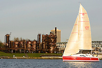 A sail boat makes its way across Lake Union in front of Gas Works Park in Seattle Saturday Dec. 8, 2007.