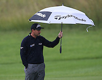 Rain and wind hamper play during the Final Round as David Howell (ENG) considers his second shot to the 9th at The Tshwane Open 2014 at the Els (Copperleaf) Golf Club, City of Tshwane, Pretoria, South Africa. Picture:  David Lloyd / www.golffile.ie