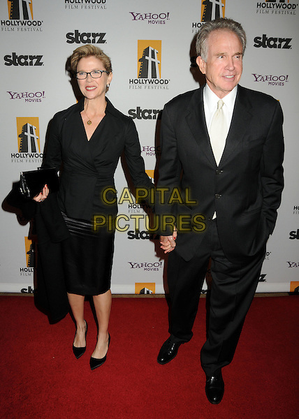 ANNETTE BENING & WARREN BEATTY.14th Annual Hollywood Awards Gala Presented By Starz held at The Beverly Hilton Hotel, Beverly Hills, CA, USA. .October 25th, 2010 .full length black glasses leather skirt top suit white shirt holding hands married husband wife.CAP/ADM/BP.©Byron Purvis/AdMedia/Capital Pictures