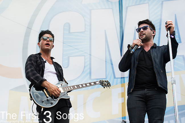 Dan Smyers and Shay Mooney of Dan + Shay perform on Day Two of the 2014 CMA Music Festival in Nashville, Tennessee.