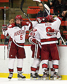 Dan Ford (Harvard - 5), Colin Blackwell (Harvard - 63), Kyle Criscuolo (Harvard - 11) and Danny Biega (Harvard - 9) celebrate Criscuolo's first collegiate goal. - The Harvard University Crimson defeated the visiting Brown University Bears 3-2 on Friday, November 2, 2012, at the Bright Hockey Center in Boston, Massachusetts.