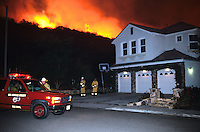 870000318 la county firemen work to protect private homes in agoura as the topanga wildfire flares up on a nearby ridge in los angeles county california