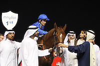 Silvestre De Sousa, the jockey of African Story, celebrates his $10,000,000 Dubai World Cup race win with Sheikh Mohammed bin Rashid Al Maktoum, UAE prime minister and ruler of Dubai (R) at the Meydan in Dubai, United Arab Emirates, Saturday March 29, 2014. With a total prize purse of US$27.25 million, the 19th running of Dubai World Cup is the world's richest day of racing. Picture by Randi Sokoloff / i-Images/DYD FOTOGRAFOS-DYDPPA