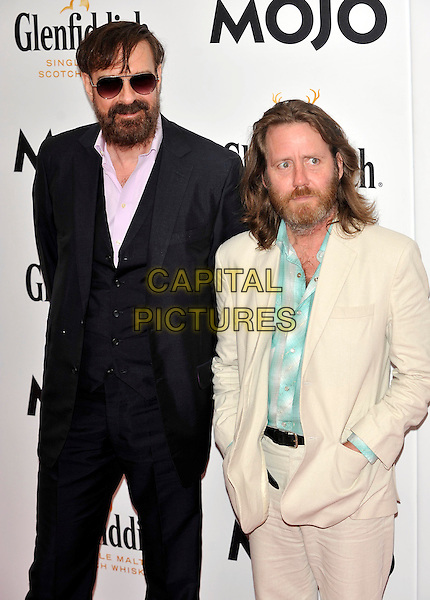 Jim Sclavunos & Martyn Casey.Glenfiddich Mojo Honours List Awards 2011 at The Brewery, London - 21st July 2011.half length black white cream suit blue shirt beard facial hair sunglasses shades .CAP/ROS.©Steve Ross/Capital Pictures